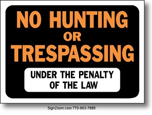 NO HUNTING OR TRESPASSING UNDER THE PENALTY OF THE LAW Sign