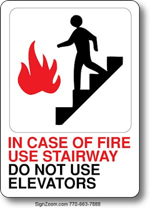 IN CASE OF FIRE USE STAIRWAY. DO NOT USE ELEVATORS. Sign